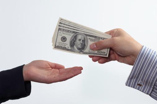 Man-Handing-Over-Money